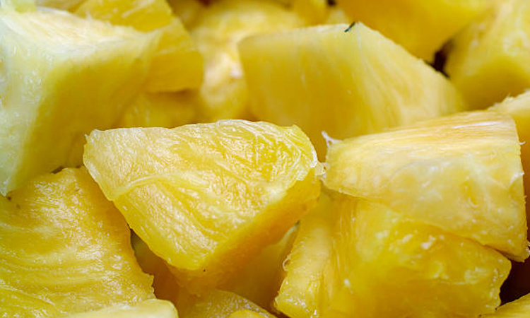 Cutting a pineapple into chunks